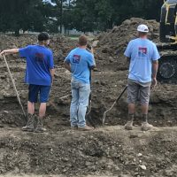 digging pools, men at work