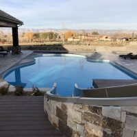 pool with stone slide