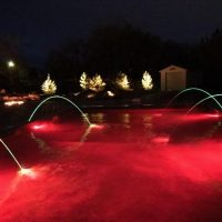 red pool lights, water feature